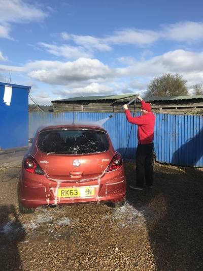 My fella Dion.... once in a lifetime sight... actually washing a car for me :-)