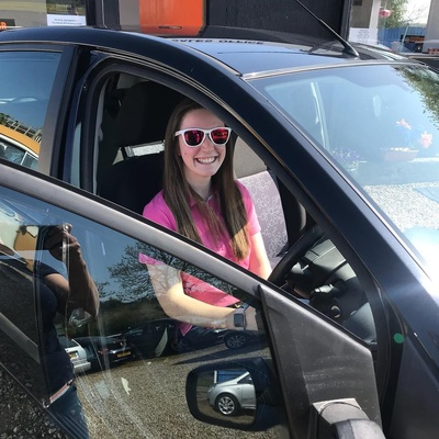 Abigail looking cool for her first drive on her own after her test... in her new car!